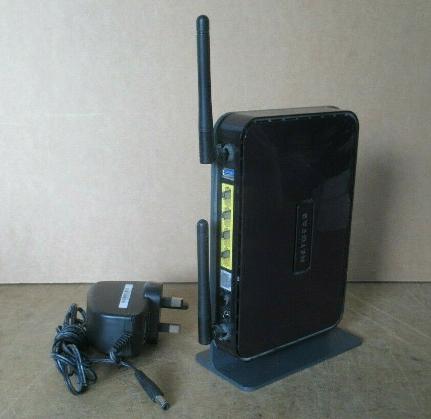 NETGEAR 300 Mbps 10/100 Wireless N 4 Port Modem Router DGN2200M With Stand